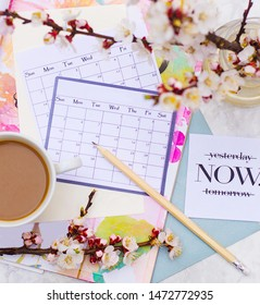 cappuccino in a white cup on a calendar and pencil background. Calendar for planning on a beautiful background. flatlay with calendar and coffee. goal setting