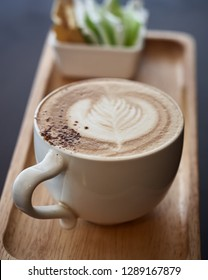 Cappuchino coffee cup at the wooden table