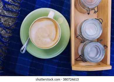Cappuchino coffee with sugar on Indigo dyed cloth