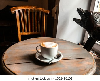 Cappuchino on the wooden table in cafe