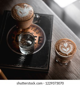 cappucino, coffee and glass of water