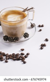 A Cappucino cup and coffee beans on white background