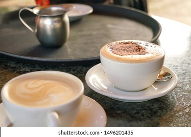 Cappucino with Flat White coffee on table in a cafe