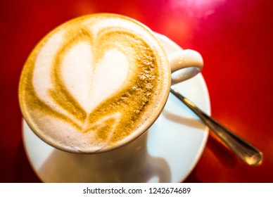 cappucino with heart - close up - photo