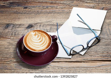 Cappucino with heart shape, letters, envelope and eyeglasses on Textured Black marble table