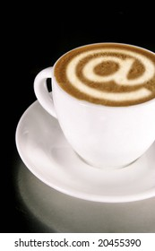 A cappucino with latte art at symbol