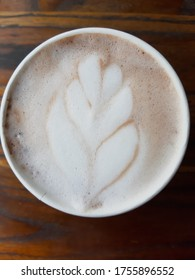 Cappucino leaf. A cup of cappucino with leaf sylhoutte.