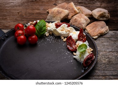 Caprese Appetizer with Mozzarella Bufala and dry tomatoes