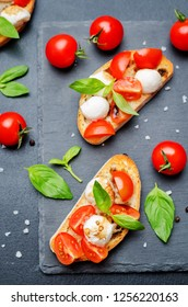 Caprese bruschetta with fresh tomatoes and Basil leaves. toning. selective Focus