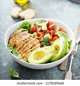 Caprese lunch bowl with grilled chicken and avocado