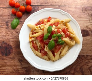 Caprese pasta salad is a incredibly popular classic summer dish. Caprese pasta salad  with tomatoes,  mozzarella cheese,  basil, olive oil, dressing and herbs.
