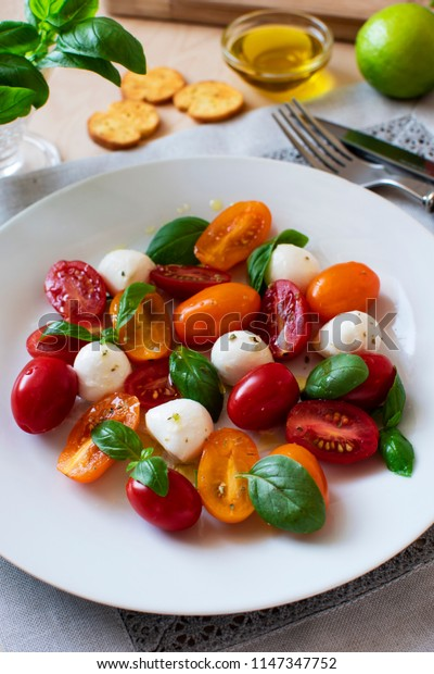 caprese salad and croutons