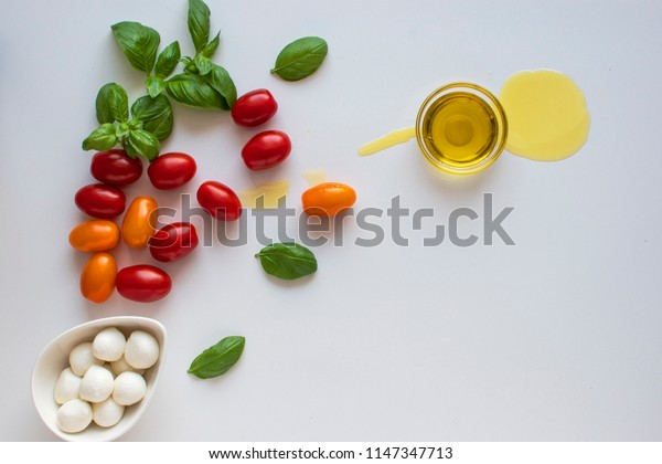 Caprese salad ingredients on a white background