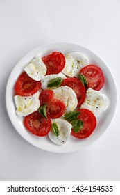 Caprese, or Caprese Salad (Insalata Caprese) is a famous and traditional Italian entrée or Anti pasto. A Caprese salad is made from fresh tomato, buffalo mozzarella, basil, olive oil, salt and pepper