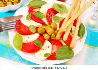 caprese salad with mozzarella,tomato,basil and grissini