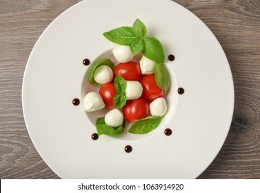 Caprese salad skewer with tomato, mozzarella and basil italian food and healthy vegetarian diet.