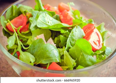 Caprese salad with tomatoes and arugula. Fresh salad with chicken, cherry tomatoes and green arugula close-up. Healthy food. Diet food appetizer fresh vegetarian tasty meal.