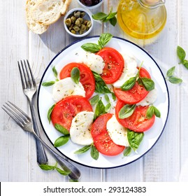 Caprese salad.Simple and tasty starter of fresh tomatoes, mozzarella cheese and basil