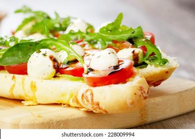 Caprese sandwiches of mozzarella cheese, tomato and basil