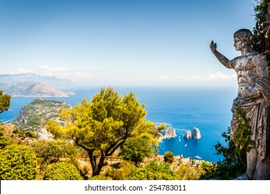 Capri, beautiful and famous island in the Mediterranean Sea Coast, Naples. Italy. Scenics of Faraglioni and seascape from Anacapri, aerial point of view.