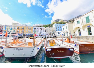 Capri Island, Italy - APRIL 13, 2019: View of Colourful Buildings with Tourist Boats at Capri Island