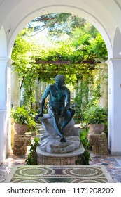 Capri, Italy - 2015-06-27 : A pergola with a Roman statue adorning Villa San Michele between the towns of Anacapri, and Capri, Italy