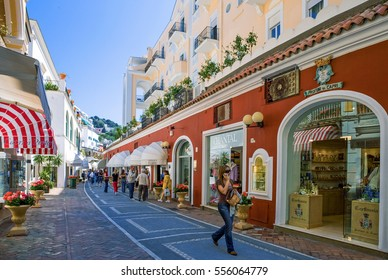 Capri, Italy - April 22, 2007: Tourists and luxury shops of the Marina Grande old village