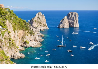 CAPRI, ITALY - AUGUST 18, 2014: Gorgeous landscape of famous faraglioni rocks on Capri island, Italy. Capri is located on Tyrrhenian sea. It has been a resort since the time of Roman Republic.