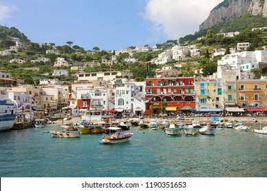 CAPRI, ITALY - JULY 4, 2018: boats for tourists in the Marina Grande harbor, Capri, Italy
