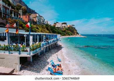 CAPRI, ITALY, MAY 10, 2017: a beach cafe overlooking the clear sea waters at Marina Grande in the beginning of tourist season.