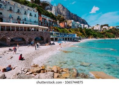 CAPRI, ITALY, MAY 10, 2017: crystal waters  of Marina Grande Beach in the beginning of tourist season.