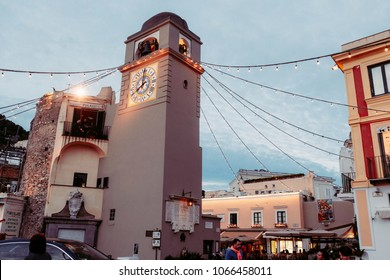 CAPRI, ITALY, MAY 10, 2017: Clock tower of Church of Santo Stefano in the evening at Piazza Umberto I, the famous square of the island of Capri, Italy.