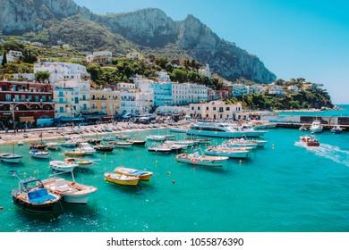 CAPRI, ITALY - May, 13, 2017: fishing boats moored at Marina Grande on a bright spring day.