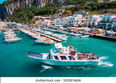 CAPRI, ITALY - May, 13, 2017: an excursion boats taking tourists fro Marina Grande on a voyage around the island on a bright spring day.
