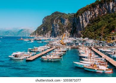 CAPRI, ITALY - MAY 13: fishing boats moored at Marina Grande on a bright spring day of May, 13, 2017.