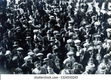 CAPRI, ITALY, NOVEMBER 1, 1926 - Citizens gathered in the famous square of Capri listen to the news via radio on the attack on Mussolini the day before