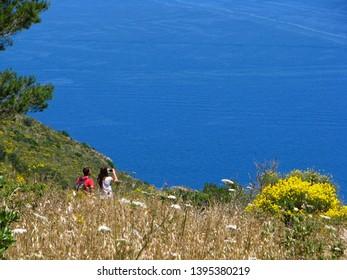 Capri,Campania,Italy-27 June 2011: The young couple of travelers admires a landscape. Island of Capri, Campania, Italy