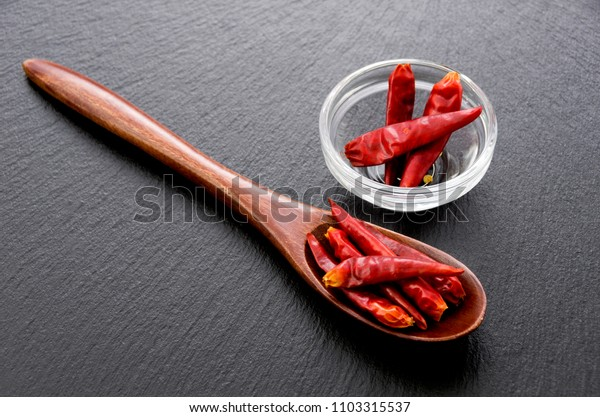 Capsicum annuum in a Wooden spoon on stone plate