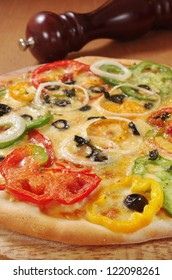 Capsicum Pizza with pepper grinder