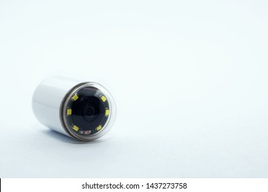 Capsule with camera for capsular endoscopy close up on white background, copy space