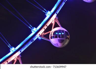 The capsule of a Ferris wheel at night in Las Vegas.