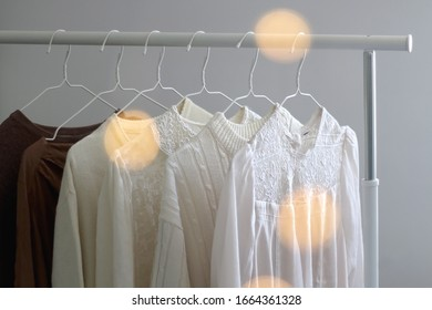 Capsule wardrobe in white and neutral tones. Selective focus.