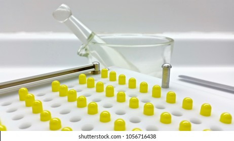 Capsules compounding in the pharmacy laboratory in macro view