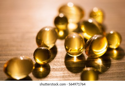 Capsules of a vitamin E and fish fat - closeup shot