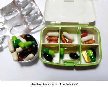 Capsule,tablet, pill, soft gel form of supplement vitamin mineral which help antioxidant activity,support heart, brain,eye, skin, joint and immune system that keep in the plastic set box and lid.