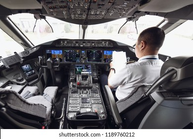 """The captain and first officer of the cockpit of the Boeing b787-9 """""""" dreamliner"""" """"of Shanghai airlines are preparing for taking off in kunming, yunnan province, China, sept 26, 2018."""