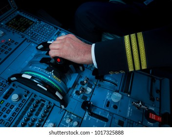 Captain hand accelerating on the throttle in commercial airliner
