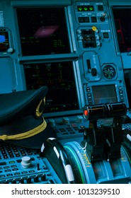 Captain pilot hat inside an airplane cabin
