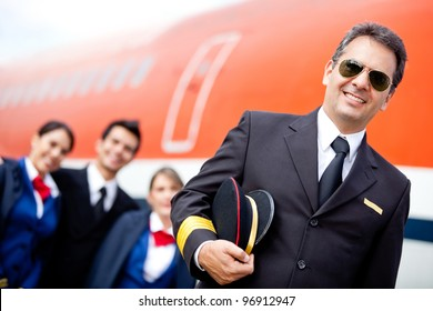 Captain pilot with his cabin crew at the airport
