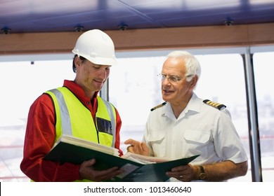 Captain of a ship discussing with a work